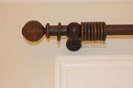 Wooden curtain pole fitting